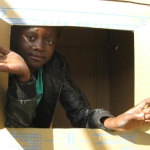 Mereille in a box house