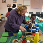 Friend of Preca Community helping with the craft class on Friday nights